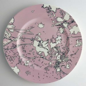 White bone china dinner plate with pink, white and black abstract floral pattern