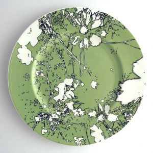 White bone china dinner plate with green, white and black abstract floral pattern