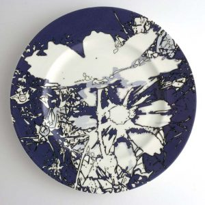 White bone china dinner plate with dark blue, white and black abstract floral pattern