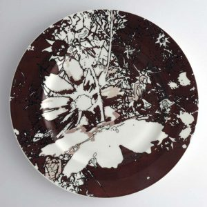 White bone china dinner plate with dark brown, white and black abstract floral pattern