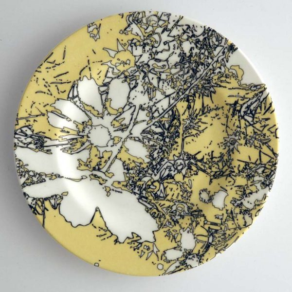 White bone china dinner plate with yellow, white and black abstract floral pattern