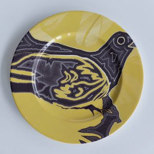 White Bone china charger with yellow and black abstract surface pattern