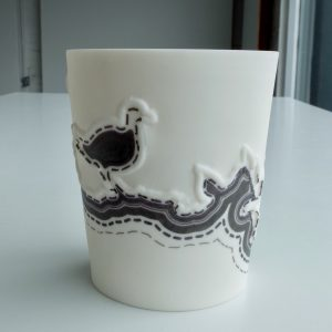 Handmade small white porcelain vessel featuring low relief birds and black line decoration. Decorative item.