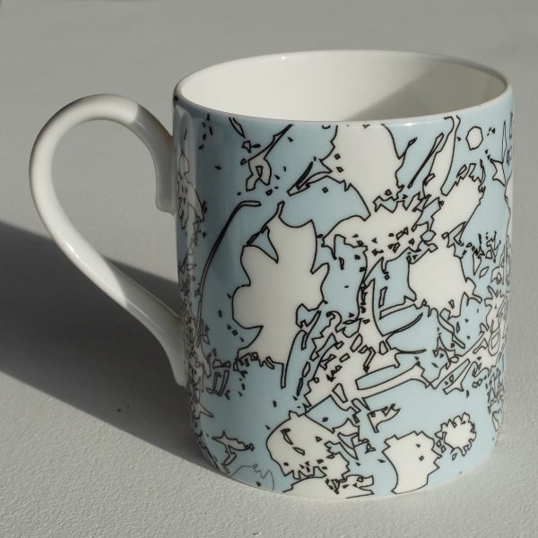 Small white bone china mug with blue, white and black abstract floral pattern