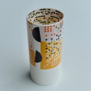 White fine porcelain vase with multi-coloured dot pattern on inside and outside surfaces