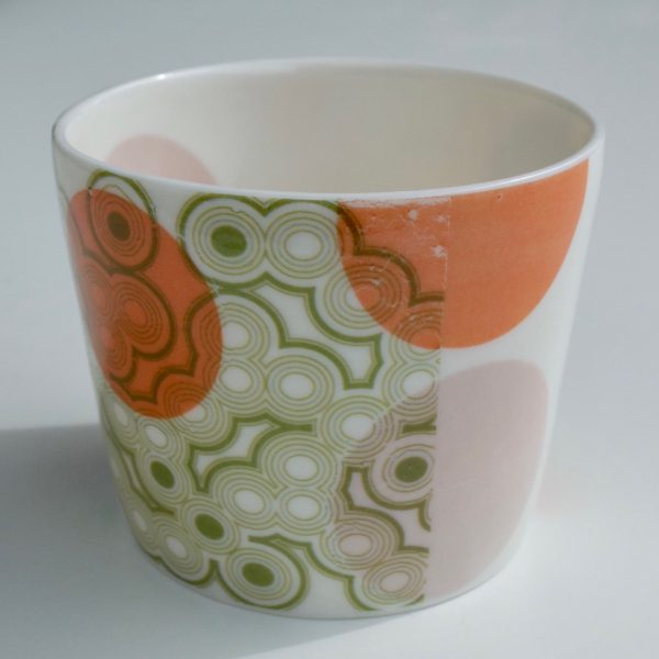 Small white fine porcelain vessel with multi-coloured dot pattern on inside and outside surfaces