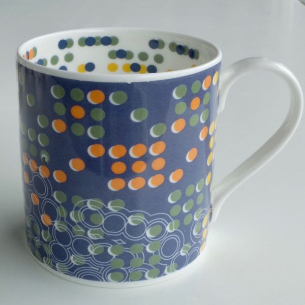 White bone china mug with hand applied blue and multicoloured dot surface pattern