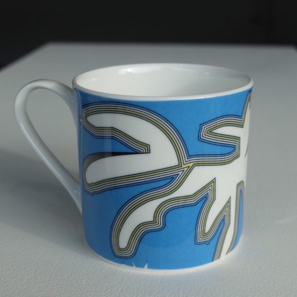 White bone china mug with hand applied blue, yellow and black abstract chinoiserie pattern
